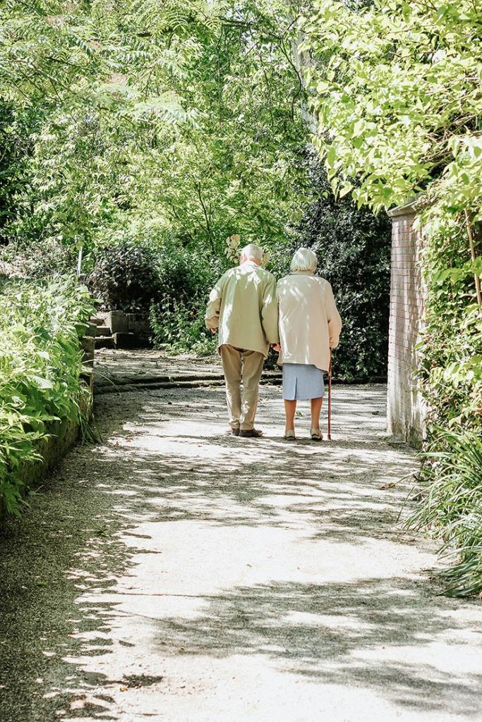 Bulli Community Centre elderly couple walking in garden